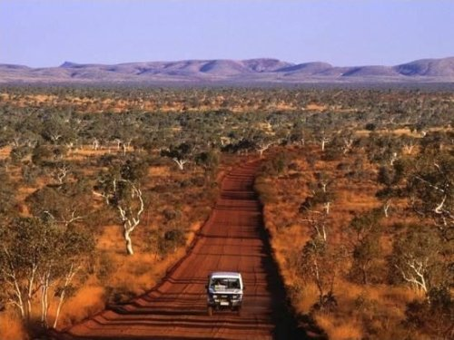 Car on Outback Road, Karijini National Park, Australia