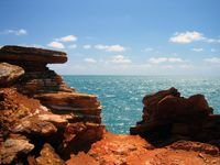 Red rocks on the Broome coast contrasted against the waters of the Indian Ocean.