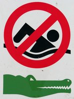 A sign, warning that the water here is infested with Australian crocodiles.