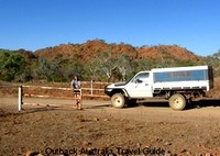 Opening one of many gates on Australian Outback road