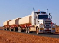 A road train pulling three tanks
