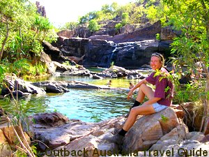 Sitting at the top of a waterfall in the Australian Outback.